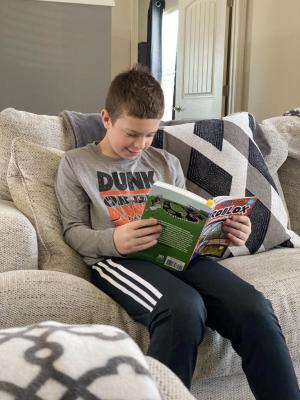 Kyler McKinnon enjoys a good book.