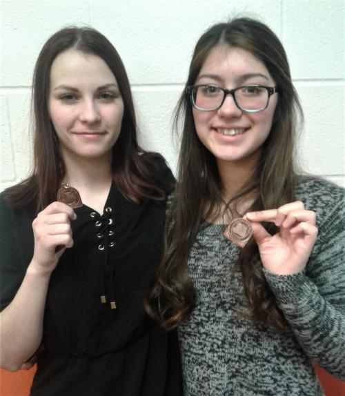 Forensics students with medals