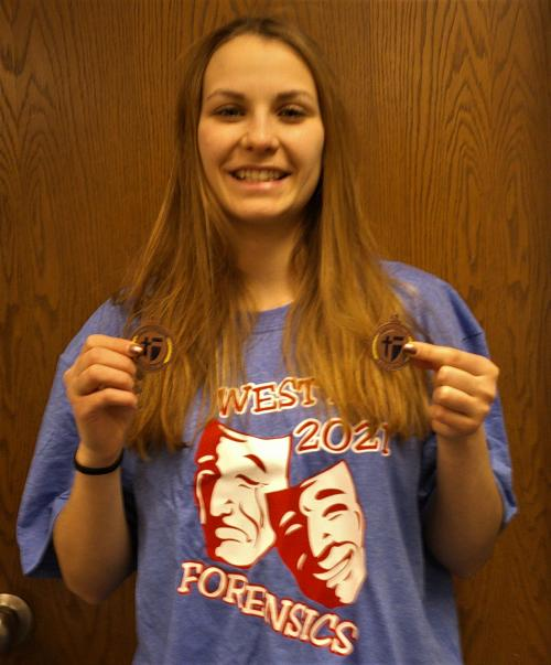 Student with Forensics medals