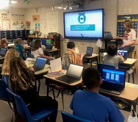 students using chromebooks to train AI