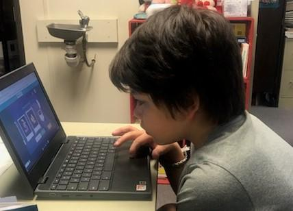 Student coding on chromebook