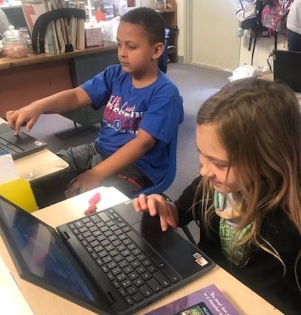 Students coding on chromebooks
