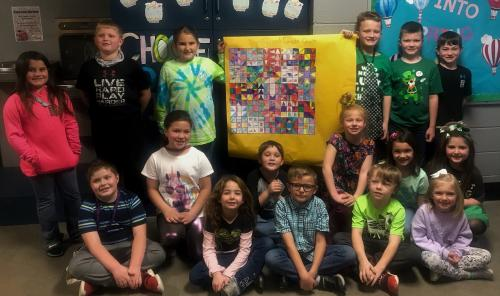 Students with quilt project