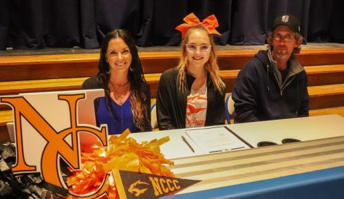 Jennifer McDow, Molly Roe, and her father Billy Roe at her Cheerleading Signing
