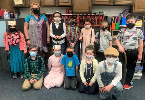 2nd grade teacher and students dressed up as 100 year olds.