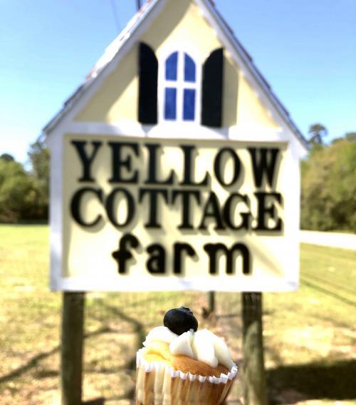 yellow cottage signage