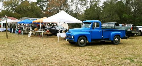 yellow cottage blue truck