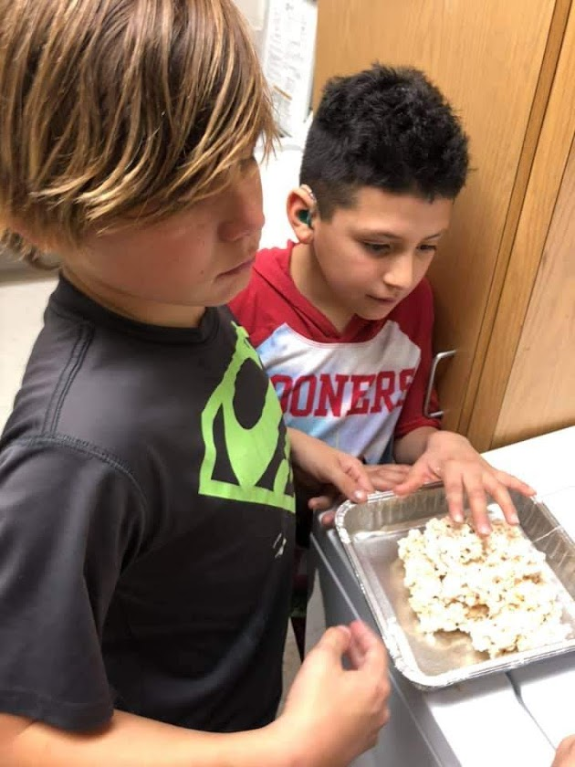 student learning to cook