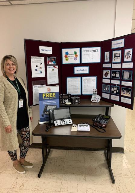 Brandy Johnson displays telephone and other adaptive equipment available through Oklahoma School for the Deaf's Equipment Distribution Program at employment fairs, senior centers and community events.