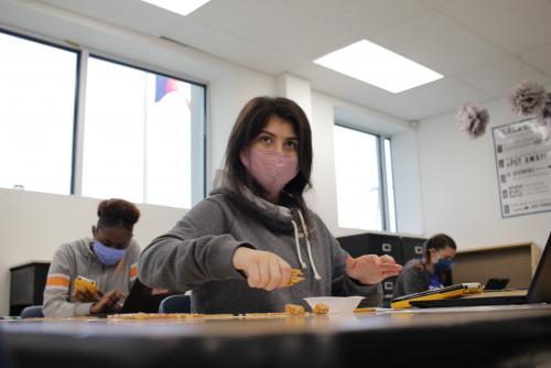 Mask wearing student during pretzel lab