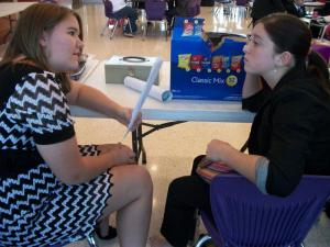 Erin and Mercedes run their memory work before going into their round and winning first in humorous duet.
