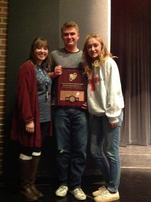 Senior Mercedes, Grant, and Macy and the state plaque.