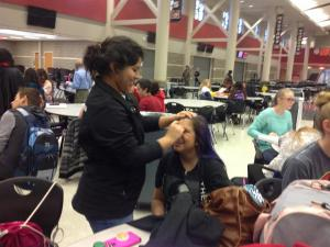 Judy helps Alisha with make up.