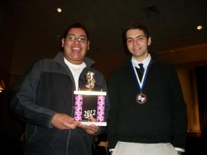 The two seniors who went to Cordell w/ the second-place sweepstakes trophy