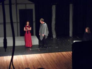 Sawyer as Aegeus questions Medea.