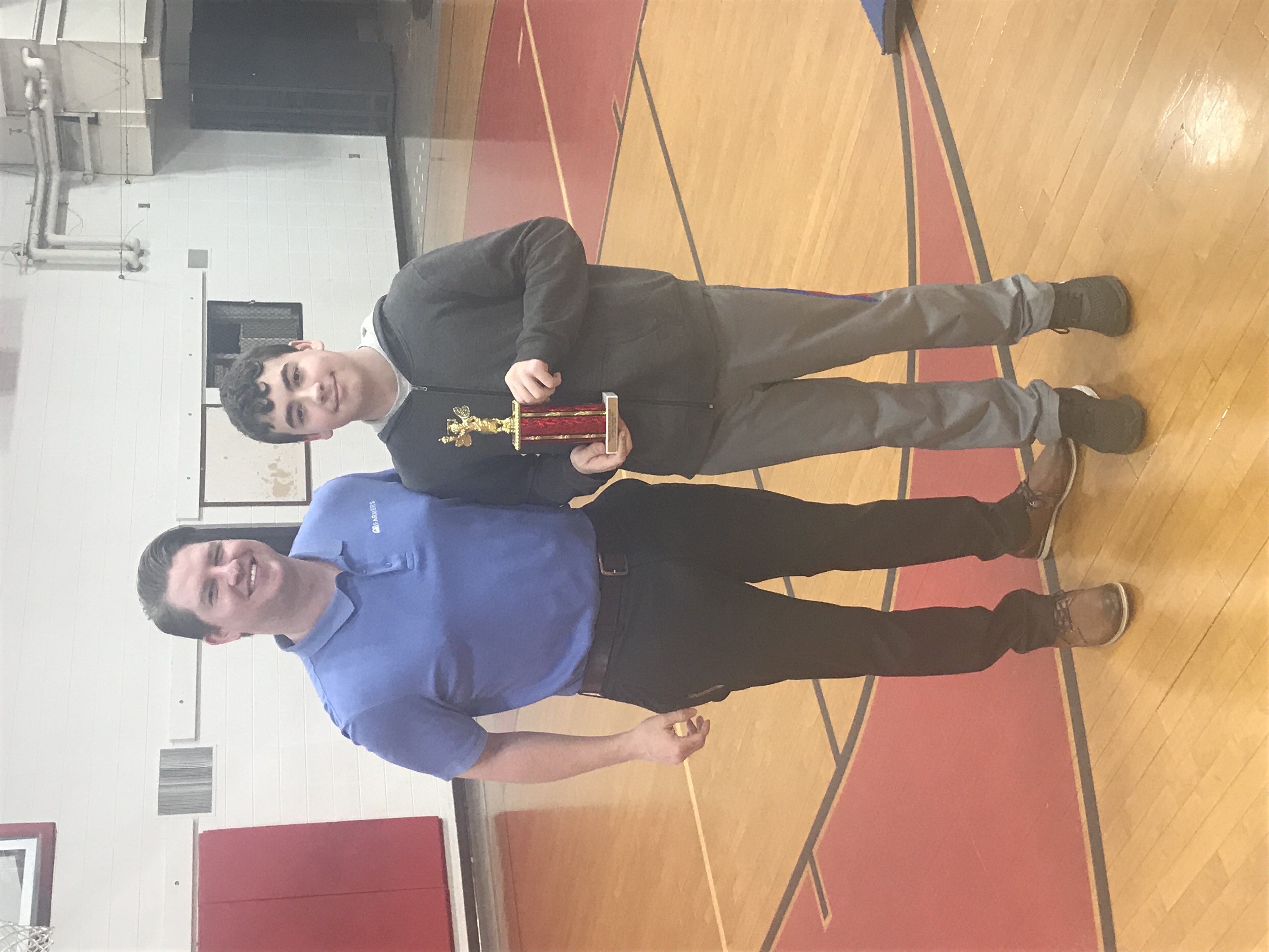 7/8 Spelling Bee 1st Place Aden Bailey & Mr. Elliott of Farmer's Bank