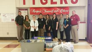 Mercy Health system donated supplies including backpacks, hygiene kits, paper, binders, towels, washcloths, clothing and much more to all three campuses at Mansfield School District.  These supplies will be to help students in need.  Pictured are L to R: