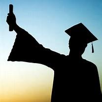 High School Student in cap and gown holding up a diploma