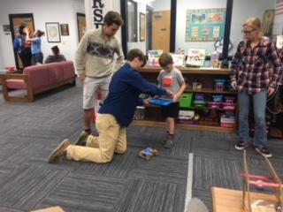 Noah Eskew giving a robotics lesson