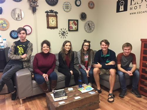 Kendal Glomski and students at Escape Room