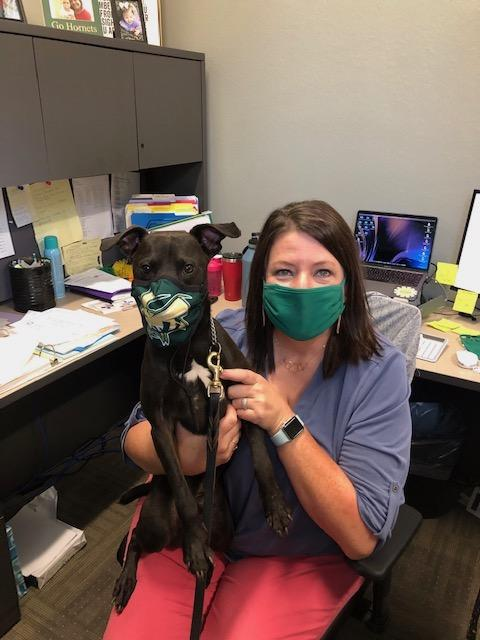 Stacy Gauldin and Iko wearing masks