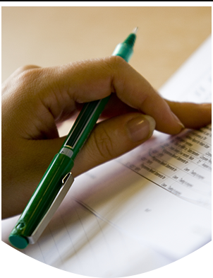 Close up image of hand holding a pen