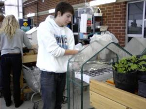 student working in EHS greenhouse