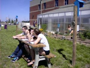 students using flip top table benches (built by students)
