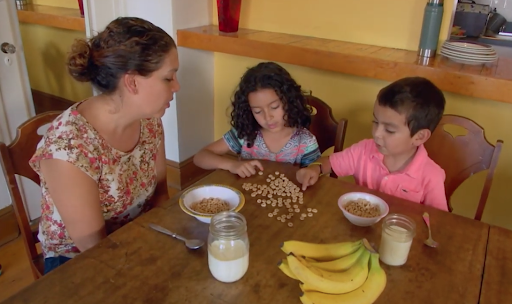 Kids counting cereal