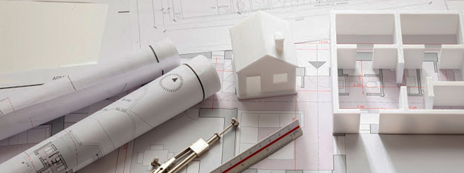 Architectural plans and three-dimentional home model on a table