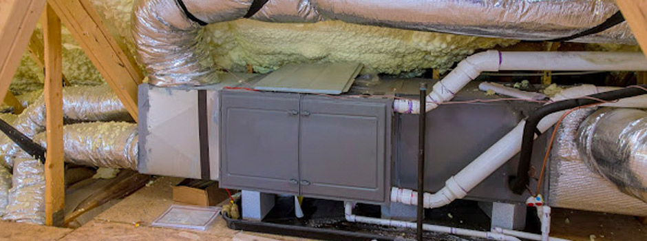 A heating and air conditioning unit in the attic of a home.