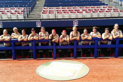 softball team in the dugout