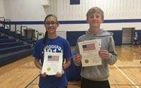 Two students accept awards