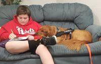 Student with our therapy dog