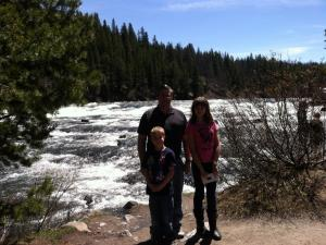 My family at Yellowstone next to a roaring river.