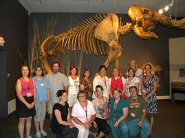 teachers in front of elephant skeleton