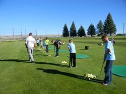 students learn how to golf