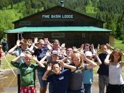Students in front of Pine Basin lodge