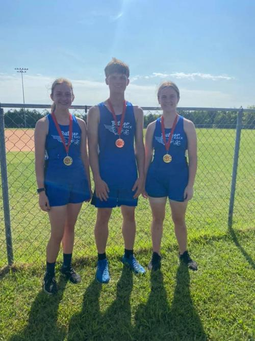 CROSS COUNTRY BRINGING HOME THE MEDALS