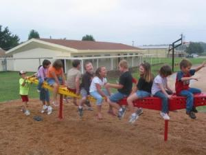 Students enjoying the new playground toy,