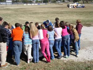 5th Grade students watching how erosion happens along the banks of a river