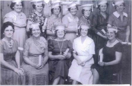 Adult Night Typing Class: STANDING - Lucille Henk, Stella Brown, Ruth Hyatt, ZIna Frederick, Gladys McCurdy, Bennie Goss; SITTING - Wilma McDaniel, Myrl Finch, Gladys Lowden, Mary Harter, and Bethel Lee