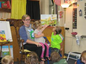 Ethan's mom reading to the class!