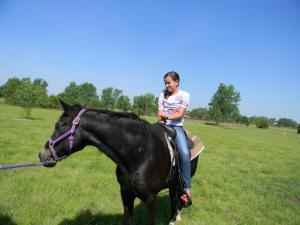 Hanna loves riding horses
