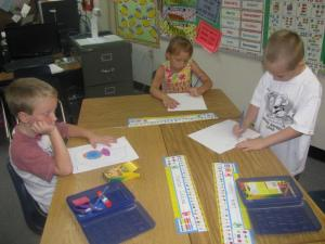 FIRST GRADERS HARD AT IT.