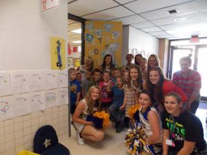 Cheerleaders award our class with spirit stick for our