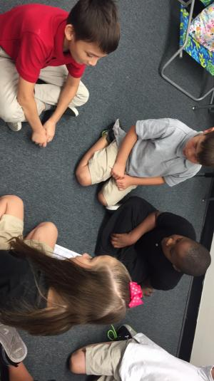 Mrs. Wright's Class playing Roll The Place Value. 8-26-19