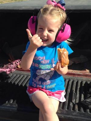 Taylor enjoying two of our favorite things.....target shooting and donuts!