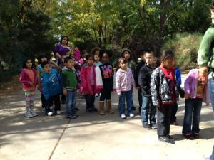 Before the field trip, the children practiced walking with partners.