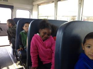 Kiyona rides the school bus to El Rancho Exotica.
